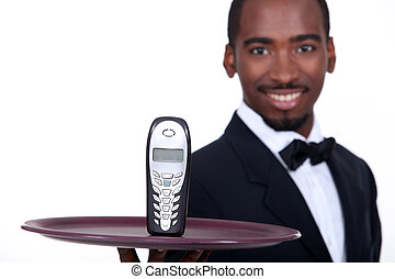 black waiter showing a phone