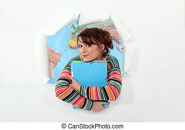 Girl stood with folders in front of atlas