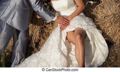 Bride and fiance on a haystack - Bride and fiance embracing...