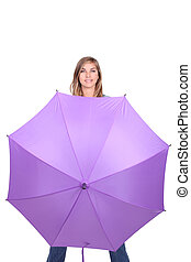 Young woman posing with an open umbrella in bright purple