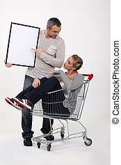 Couple with a shopping trolley