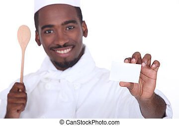 Chef holding a blank business card