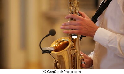 Playing saxophone - Close up on the hands of a sax player