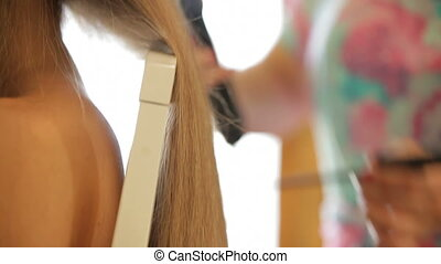 Setting bride's hair - Woman doing bride's hair for the...