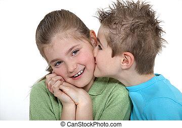Boy kissing a girl on the cheek