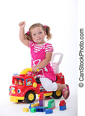 Girl on a toy car