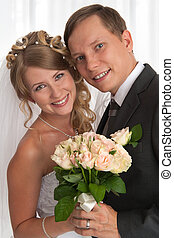 groom and bride in white dress - portrait of groom and bride...