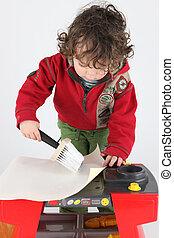 Little boy wall papering