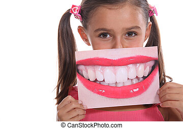Little girl holding photo of mouth