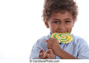 Boy eating a lolly pop