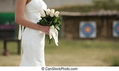 Bride waiting for the groom - Bride standing with a bouquet...