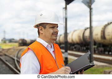 Engineer at the station near the wagons