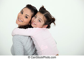Woman giving her daughter a piggy back ride