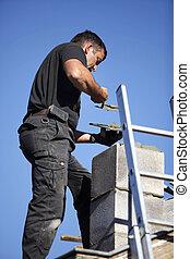 Roofer making a chimney stack