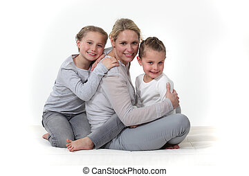 Woman hugging her children