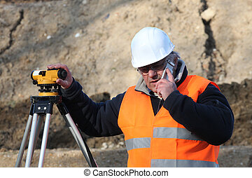 Surveyor on the phone