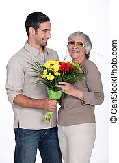 Son giving mother flowers