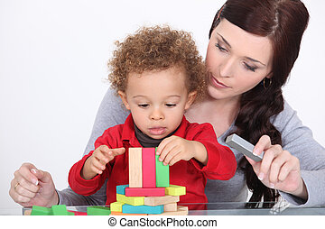 Woman playing with her child