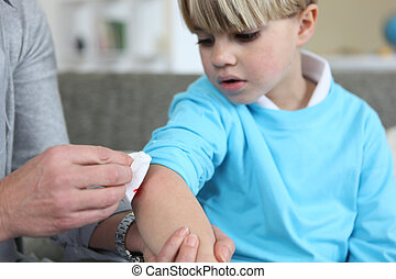 Little boy with grazed elbow