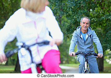 Middle-aged couple on a bike ride