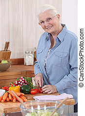 Elderly lady preparing vegetables