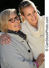 Woman with her teenage granddaughter
