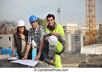 Un, equipo, construcción, trabajadores