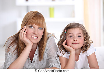 Mother and daughter relaxing at home