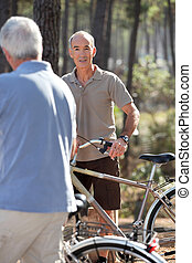 Grey haired man on bike ride