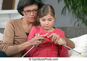 Little girl learning to knit