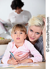 Mother helping daughter with homework
