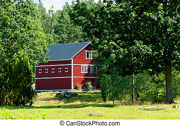 Red painted wooden barn in Sweden