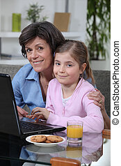 Young girl spending time with grandma