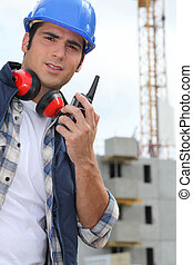 Foreman with radio on site