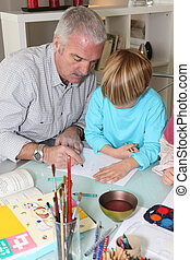 Grandfather with grandson drawing
