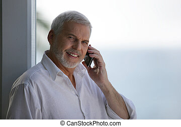Older man with a telephone