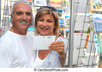Couple looking at postcards