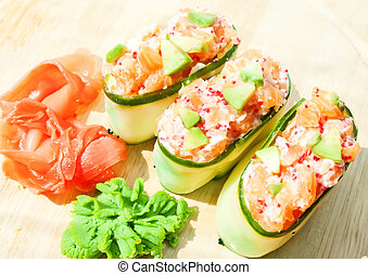 Fresh cucumber sushi with salmon, roe and avakado - Fresh...