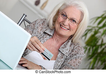 Elderly lady shopping on-line