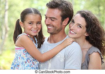 Portrait of parents with child
