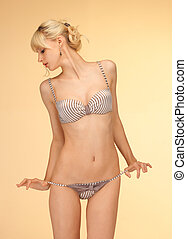 undressing woman in sexy lingerie - picture of undressing...