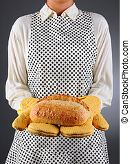 Homemaker Holding Fresh Loaf of Bread - Closeup of a...