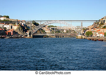 view of Douro river with D. Luis bridge connecting both margins