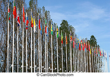 world flags - several world flags alligned on a street with...