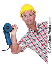 Man holding angle grinder in one hand