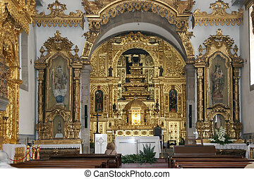 portuguese church altar with rich golden decoration