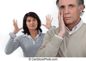 Mature woman frustrated with her husband