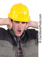 Tradesman covering his ears