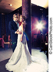 embracing couple - Charming bride and groom on their wedding...