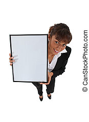 woman in a suit holding an ad board